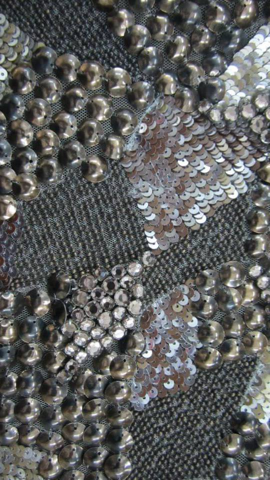 Oxidized metallic cup sequins with crystals and metal beads on leather