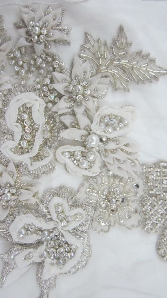 Motif of manipulated georgette with silver bullion work and pearls on silk chiffon