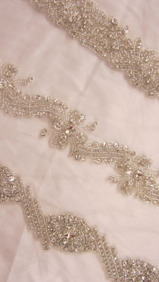 Bridal trims made with rhinestone, one cut and glass seed beads on tulle