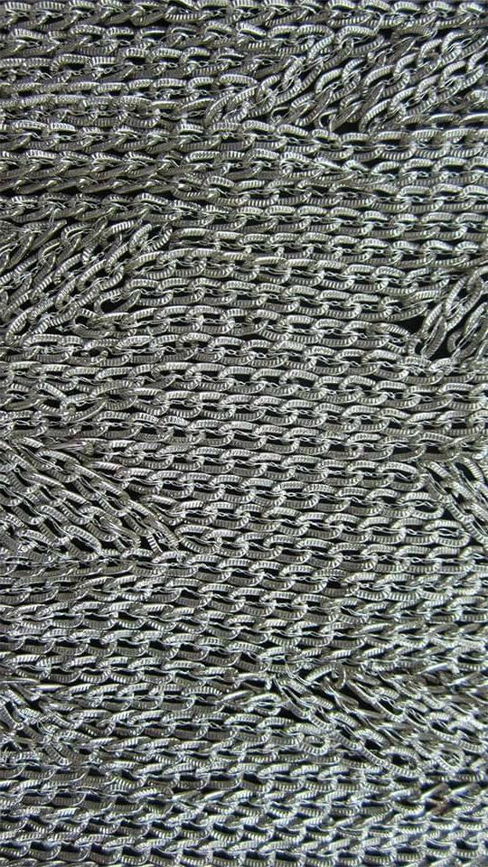 Chainmail sewn with bullion thread on georgette